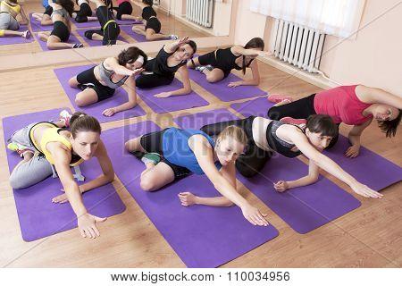 Fitness, Sport And Healthy Life Concepts. Group Of Seven Young Caucasian Females Having Fitness Clas