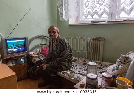 VINNITSY, RUSSIA - NOV 30, 2015: Elderly man in rehabilitation department in Center of social services for pensioners and the disabled. 2015 - the year of the older generation in Leningrad region.