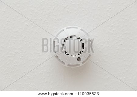 White Smoke Detector On Ceiling