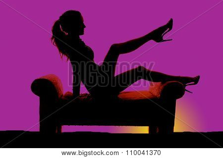 Silhouette Of A Woman In Short Dress Sit One Leg Up