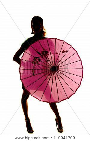 Silhouette Of A Woman Standing Behind An Umbrella