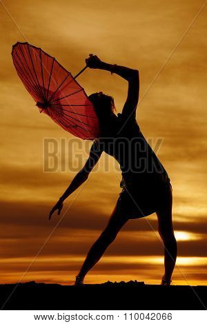Silhouette Of Woman Lean To Side With Umbrella
