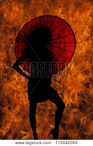 Silhouette Of Woman Knee Out Behind Umbrella