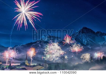 firework at new years eve in austrian snowy mountains