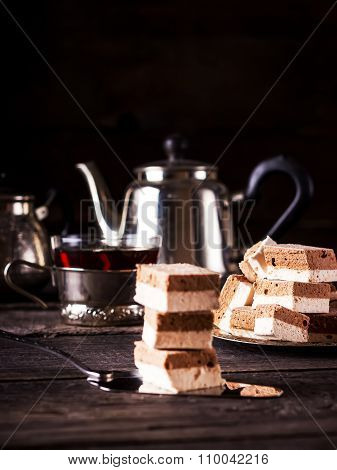 ?offee Fruit Candy Tea And Teapot On Dark Wooden Table.
