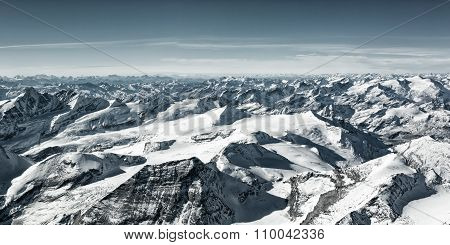 a lot of snowy mountain summits in winter at austria tyrol