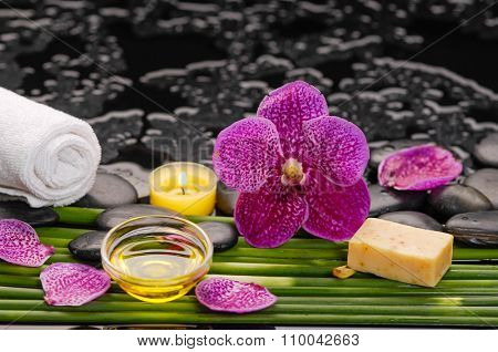 beautiful orchid and black stones,soap,candle,towel and bamboo grove