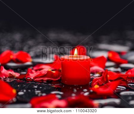 Still life with Red rose petals with candle and therapy stones