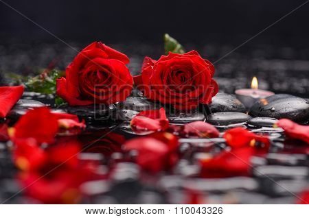 red rose ,petals with candle and therapy stones