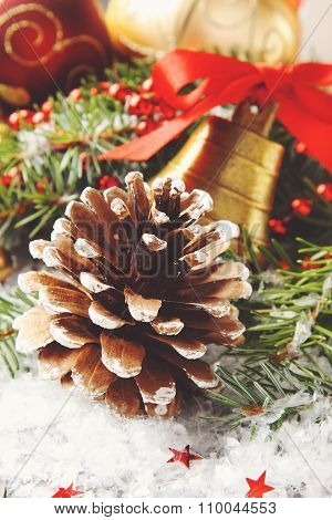 Pinecone with christmas decoration and snow
