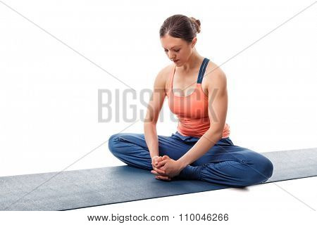 Beautiful sporty fit woman practices yoga asana Baddha konasana - bound angle pose isolated on white