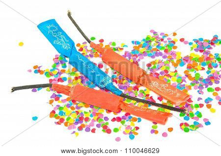 Three Petards On Background Of Colorful Confetti.