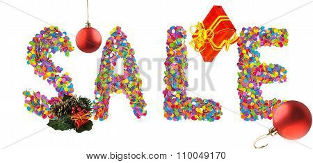Word Sale Formed Of Colorful Confetti With Christmas Decorations And Gift Box.