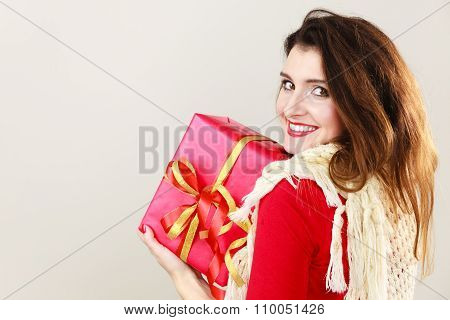 Woman With Red Gift Box On Gray.