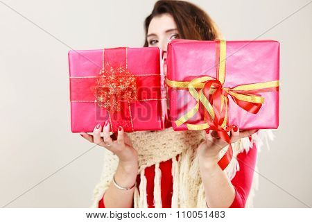 Woman With Red Gift Boxes On Gray.