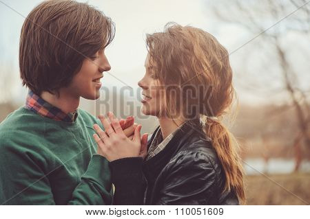 loving couple happy together outdoor on rainy walk on country side, cozy mood