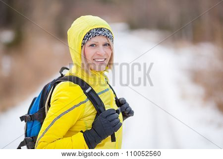 Woman Hiking And Walking In Winter Woods