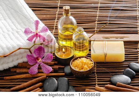 SPA set on mat with orchid ,towel,stones