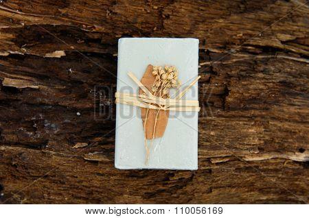 Handmade of soap on driftwood wood