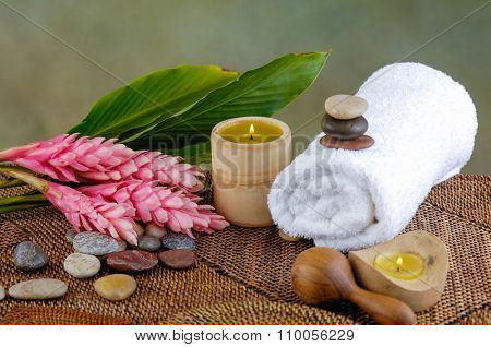 Tropical spa with candle ,red flower on mat