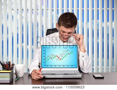 Trader  Looking On Stock Chart