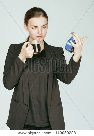 young beauty woman in business style costume waking up for work early morning on white background wi