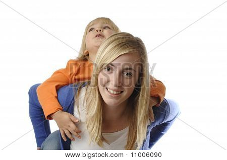 Teenage Girl Piggybacks A Toddler
