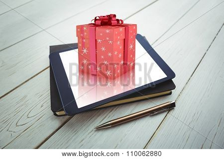 Remove against view of a book and tablet lying on desk