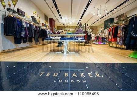 SINGAPORE - NOVEMBER 08, 2015: interior of Ted Baker store. Ted Baker plc is a British luxury clothing retail company