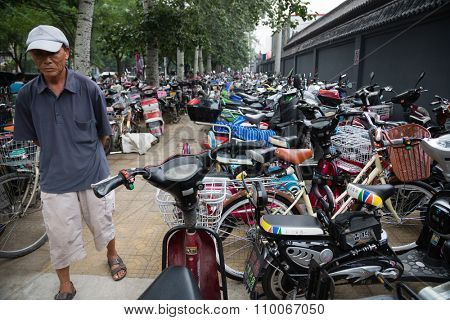 BEIJING - CIRCA JUNE, 2015: Parking scooters, motorcycles and bicycles in the center of Beijing. These kinds of individual transport is very popular among the poor segments of the population.