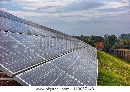 Green Energy Solar Panels On A Cloudy Day