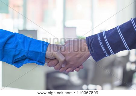 Handshake Or Businessmen  Blur In The Workplace