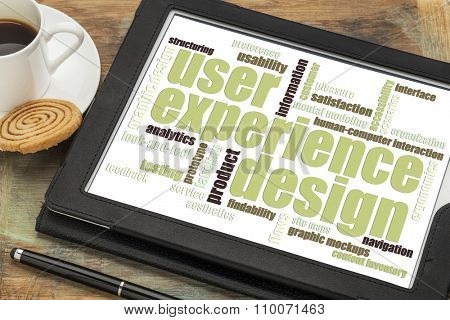 user experience design concept - word cloud on a digital tablet with a cup of coffee