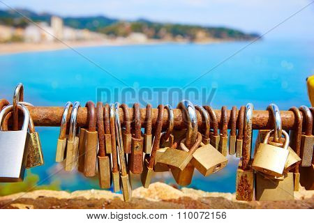 Costa Brava beach Lloret de Mar padlocks in a row Catalonia at Spain