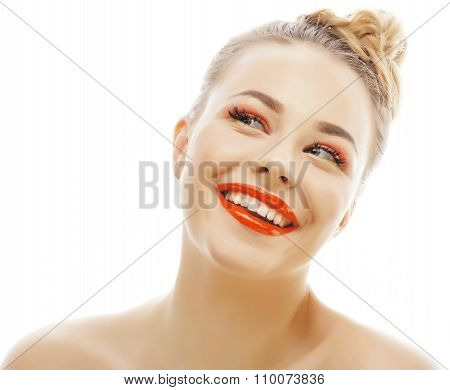 young blond woman with bright make up smiling pointing gesturing emotional isolated like doll