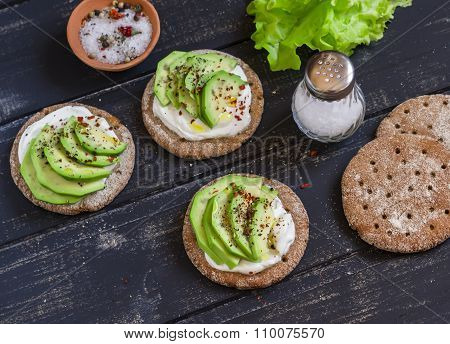Healthy Avocado Sandwiches,  On A Dark Wooden Surface. Healthy Breakfast Or Snack