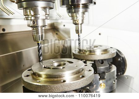 Metalwork industry. Milling machine tool with two mills in chuck preparing to process metal detail at industrial manufacture factory