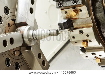 metalworking  industry. threading cutting process of steel metal shaft on turning lathe machine in workshop.