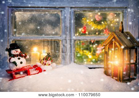 Atmospheric Christmas window sill decoration with cozy home interior