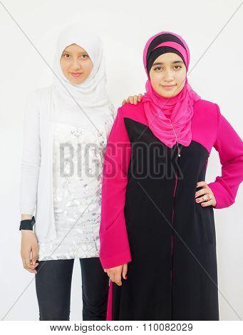 Fashion portrait of young beautiful muslim girl wearing hijab