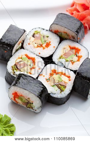 Roll made of Fresh Salmon, Smoked Eel, Avocado, Tobiko and Cucumber inside. Nori outside