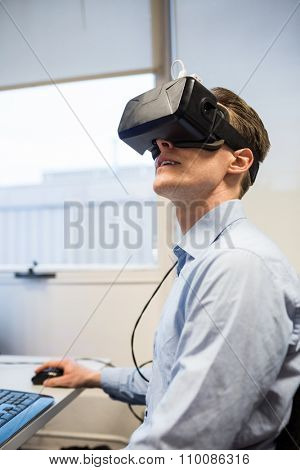 Businessman using oculus rift headset in the office