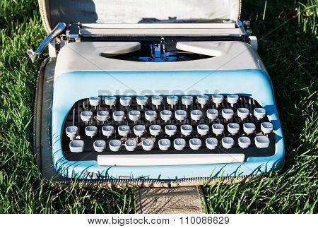 Old Retro Typewriter On The Grass