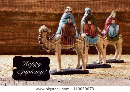 a black label with the text happy epiphany and the three kings on their camels