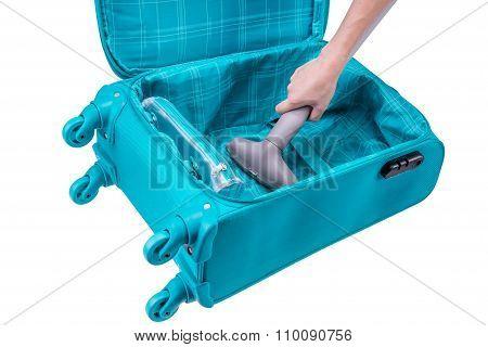 Hand Vacuum-cleans Suitcase