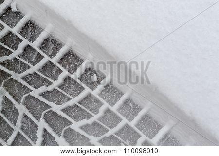 Car Tire Tracks In Fresh Winter Snow