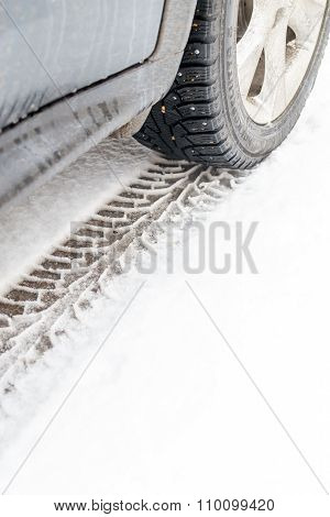 Car And Winter Tire Tracks