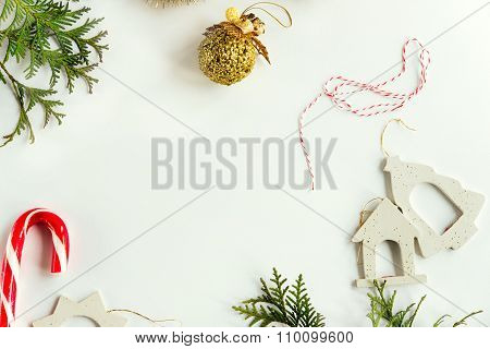 Green Branches Of Cedar Or Fir And Amazing Christmas Toys And Delicious Candy On White Background