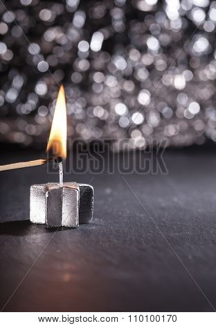 Lighting A Silver Candle With A Match