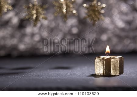 Lit Golden Candle With Christmas Decoration And Bokeh Background